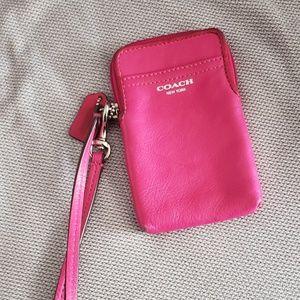 COACH leather phone case wristlet.